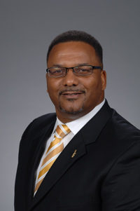 Curtis Reynolds, Vice President, Business Affairs